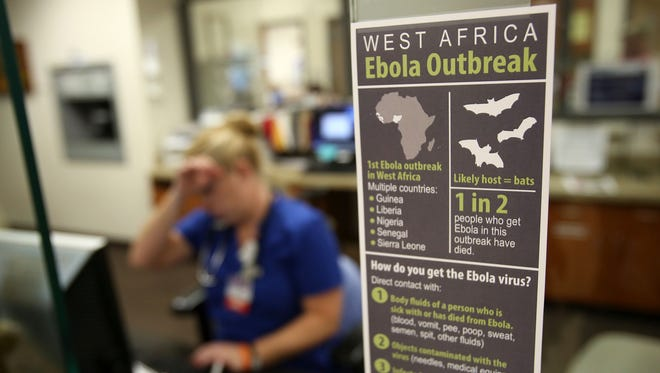 A sign in the admittance area of the emergency department at Salem Hospital describes the Ebola Outbreak and the signs of the virus. The photo was taken on Friday, Oct. 3, 2014, in Salem, Ore.