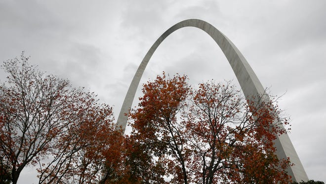 In this photo made Friday, Oct. 23, 2015, the 630-foot-tall Gateway Arch rises above trees in St. Louis. The wicket-looking landmark, the nation's tallest man-made monument and the centerpiece of the Jefferson National Expansion Memorial grounds, cost less than $15 million to build after construction began in early 1963 and is now undergoing an ambitious $380 million renovation. (AP Photo/Jeff Roberson)