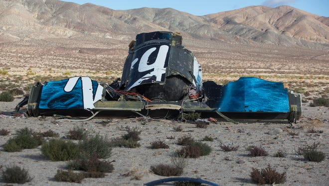 Wreckage lies near the site after a Virgin Galactic space tourism rocket, SpaceShipTwo, exploded and crashed in Mojave, Calif.