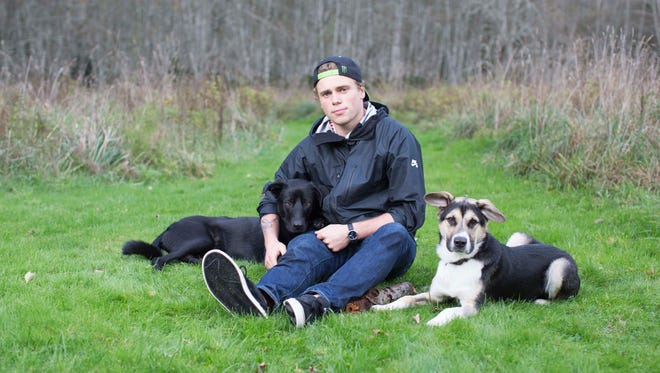 Olympic silver medalist Gus Kenworthy poses with dogs he rescued from Sochi, Russia, with his friend Robin Macdonald. Jake and Mishka will stay with Macdonald in Vancouver while Kenworthy travels for competitions this season.
