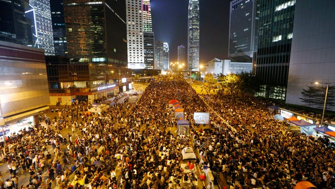 Pro-democracy protesters attend a rally in the occupied areas outside government headquarters in Hong Kong's Admiralty on Oct. 10, 2014.