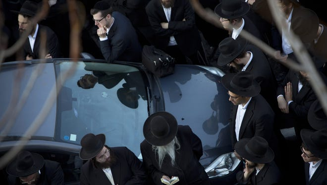 Ultra-Orthodox Jews attend the funeral of Mosheh Twersky, in Jerusalem, Tuesday, Nov. 18, 2014. Two Palestinian cousins armed with meat cleavers and a gun stormed a Jerusalem synagogue during morning prayers Tuesday, killing Twersky and three others in the city's bloodiest attack in years. (AP Photo/Oded Balilty)