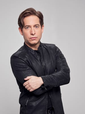 Recording executive Charlie Walk, a panelist on Fox's 'The Four: Battle for Stardom' was accused of sexual harassment Monday by a former employee.