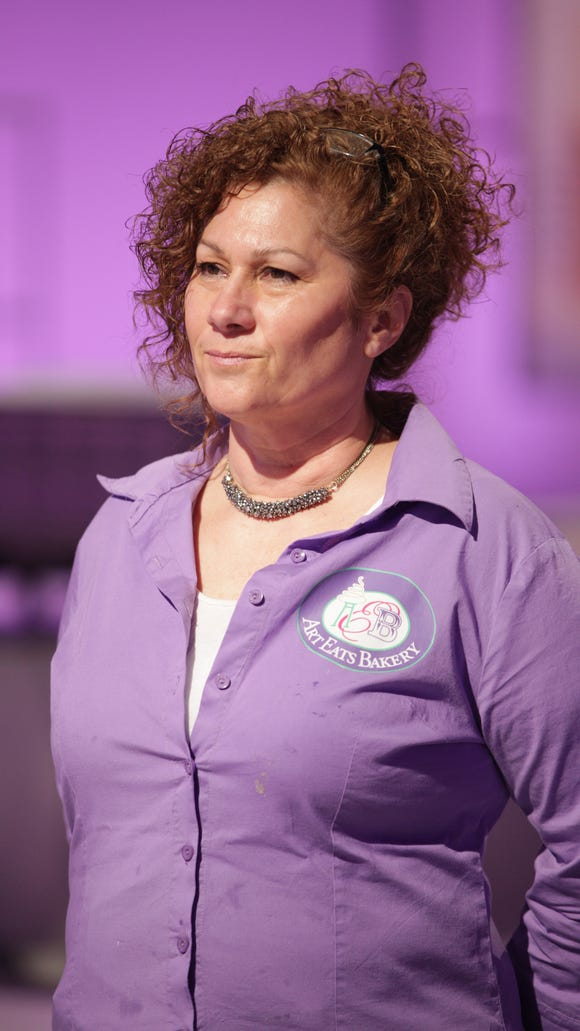"Jackie Bishop, owner of Art Eats Bakery, will appear on The Food Network show, ""Cake Wars"" Aug. 3."