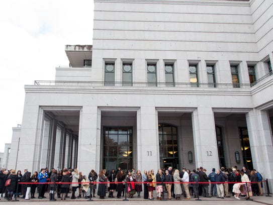 Attendees line up at the LDS Conference Center to attend