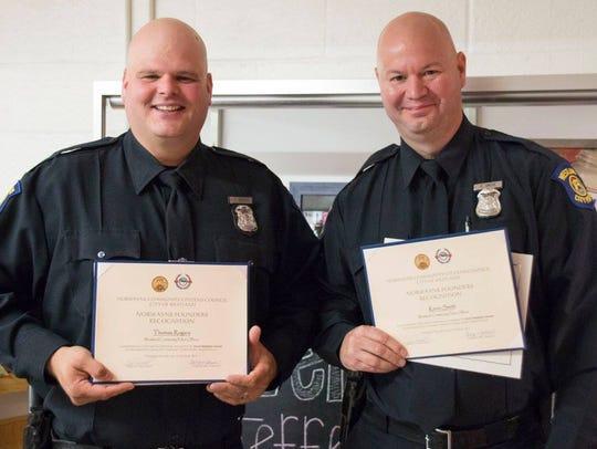 Westland Police Officers Tom Rogers (left) and Kevin