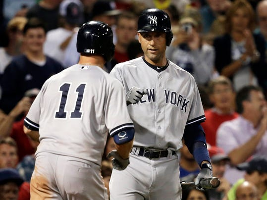 New York Yankees' Brett Gardner, left, celebrates with Derek Jeter, right, after Gardner hit a home run off a pitch by Boston Red Sox's Craig Breslow in the sixth inning of a baseball game, in Boston, Sunday, Aug. 3, 2014. (AP Photo/Steven Senne)
