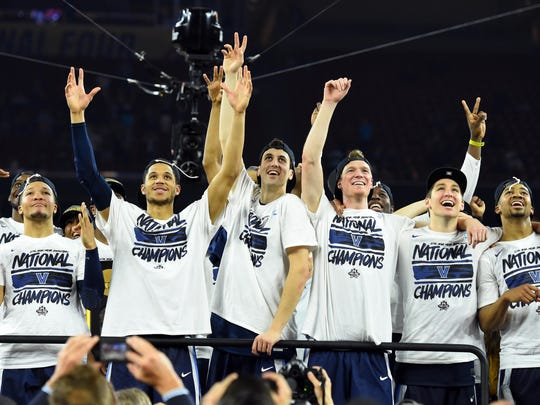 """The Villanova Wildcats watch """"One Shinning Moment"""" after beating the North Carolina Tar Heels in the championship game of the 2016 NCAA Men's Final Four at NRG Stadium."""
