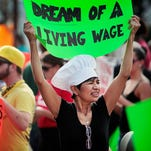 File photo: Fast-food workers and their supporters picket outside a McDonald?s restaurant in Memphis, Tenn., in 2013.