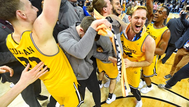 Mar 16, 2018; Charlotte, NC, USA; UMBC Retrievers celebrates beating the Virginia Cavaliers in the first round of the 2018 NCAA Tournament at Spectrum Center. Mandatory Credit: Bob Donnan-USA TODAY Sports ORG XMIT: USATSI-378327 ORIG FILE ID:  20180316_pjc_sd2_374.JPG