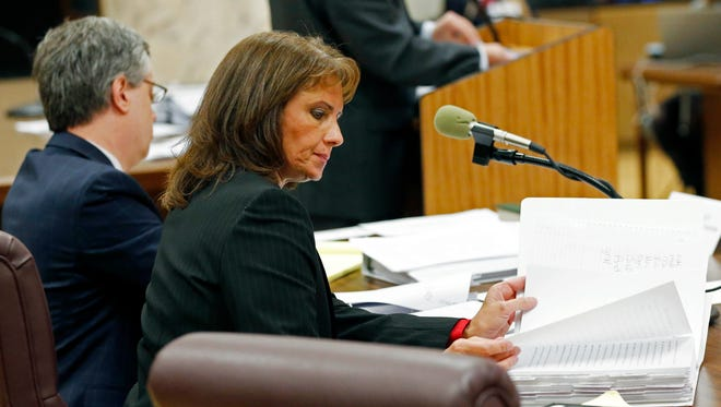 Former Republican state Sen. Melanie Sojourner, of Natchez, reviews her notes during opening arguments on her recent disputed election loss before a Mississippi Senate committee, Wednesday, Jan. 13, 2016, at the Capitol in Jackson, Miss. Sojourner is asking the Senate to overturn her loss to Democratic former Sen. Bob Dearing of Natchez. She questions the way the election was conducted in some precincts. Certified results show Dearing defeated Sojourner by 64 votes in November.