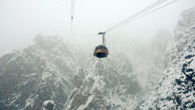 A tram car goes up to the Mountain Station of the Palm Springs Aerial Tramway in 2010.  Mount San Jacinto has received about 4 feet of snow since a series of storms began moving through southern California on Friday.