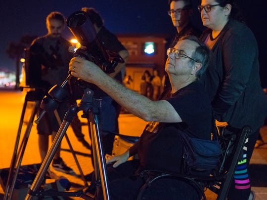 Pensacola State College astronomy professor Wayne Wooten prepares a telescope for viewing the stars during a stargazing event  on March 31, 2017, at Casino Beach. The longtime astronomy instructor will retire from the college at the end of the semester.
