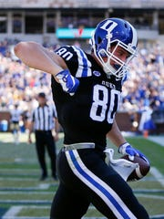 Duke tight end Daniel Helm (80) reacts after catching a touchdown pass in the first half of an NCAA college football game against Georgia Tech, Saturday, Oct. 29, 2016, in Atlanta. (AP Photo/John Bazemore)