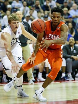 Xavier's J.P. Macura, left, and Clemson's Jaron Blossomgame go after a loose ball during the first half of an NCAA college basketball game at the Tire Pros Invitational tournament, Friday, Nov. 18, 2016, in Lake Buena Vista, Fla.