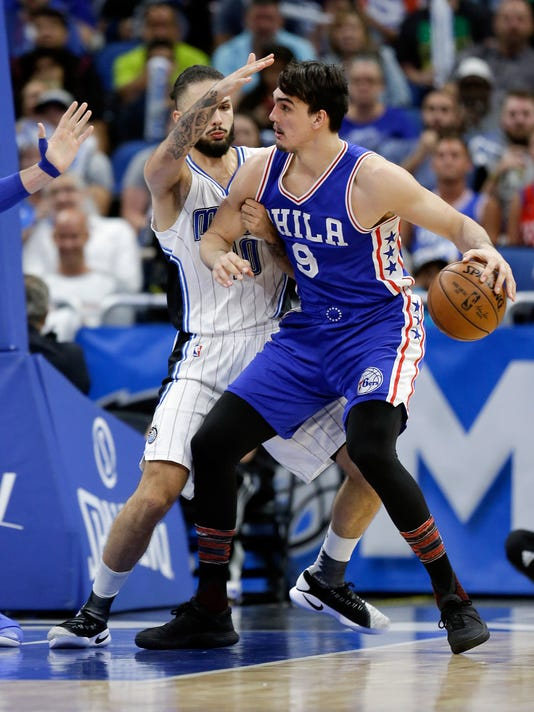 Philadelphia 76ers' Dario Saric (9) looks for a way to the basket around Orlando Magic's Evan Fournier during the second half of an NBA basketball game, Thursday, Feb. 9, 2017, in Orlando, Fla. (AP Photo/John Raoux)