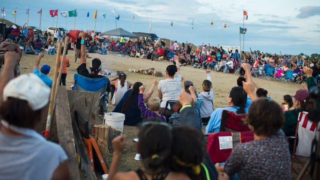 This photo taken on Sept. 3, shows members of the Standing Rock Sioux tribe and their supporters gathering in a circle in the center of camp to hear speakers and singers, at a protest encampment near Cannon Ball, N.D.