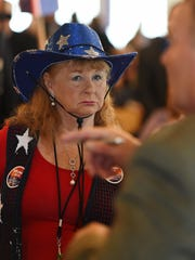 Anne Cain of Felton listens as Kent County GOP Chairman Hank McCann speaks as the state Republican Party held its convention in Dewey Beach at the Baycenter on Saturday, April 30, making decisions about candidates and picking delegates to the cational convention in Cleveland.