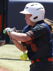 UTEP batter Kaitlin Ryder is hit with a pitch against North Texas Sunday at Helen of Troy Field.