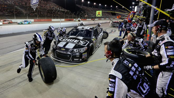 Jimmie Johnson's team elected to change just two tires on the final pit stop to give him the lead. Johnson finished third in a green-white-checkered finish.