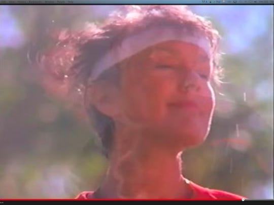 This woman finishes a jog in the 1991 Sizzler commercial.