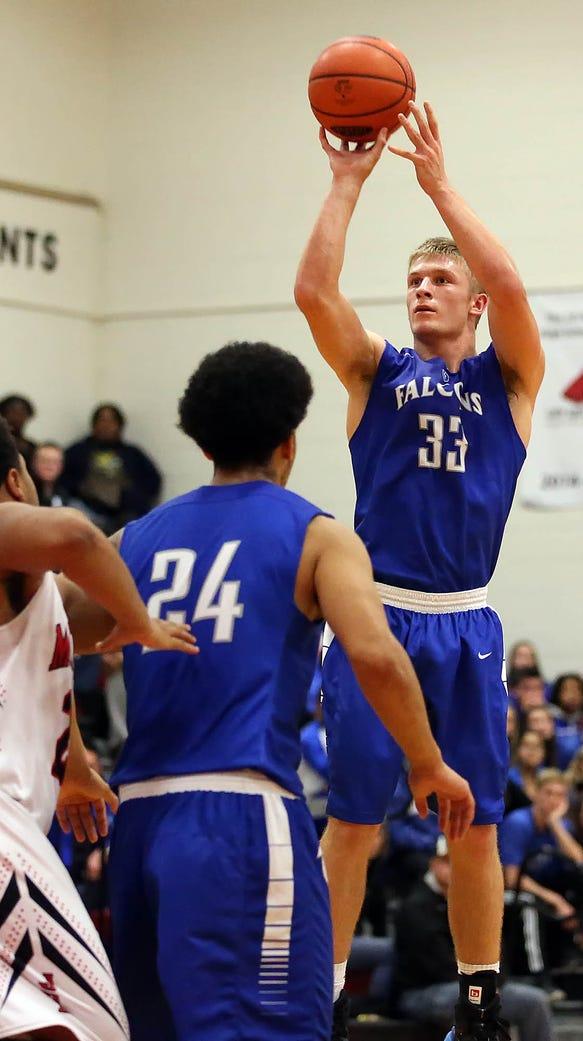 Cedar Crest's Evan Horn (33) hits a three pointer against