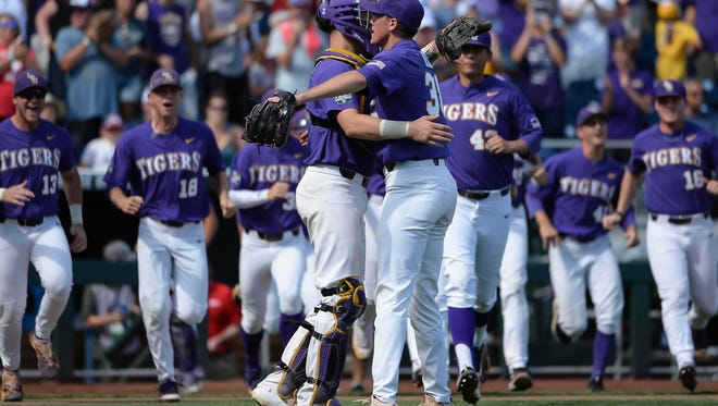 Jun 24, 2017; Omaha, NE, USA; LSU Tigers pitcher Zack Hess (38) and catcher Michael Papierski (2) celebrate the win against the Oregon State Beavers at TD Ameritrade Park Omaha. Mandatory Credit: Steven Branscombe-USA TODAY Sports
