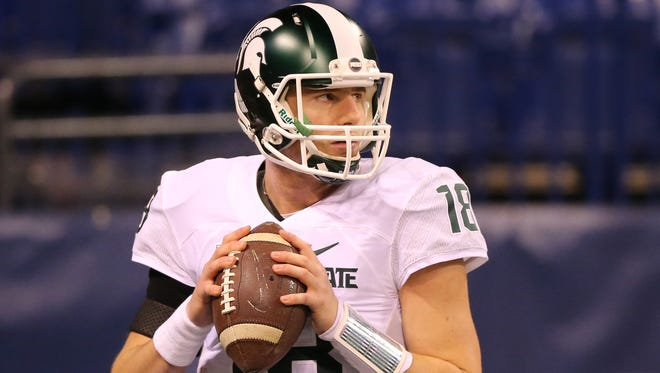 Michigan State Spartans Connor Cook warms up before the Big Ten Championship game against the Iowa Hawkeyes.