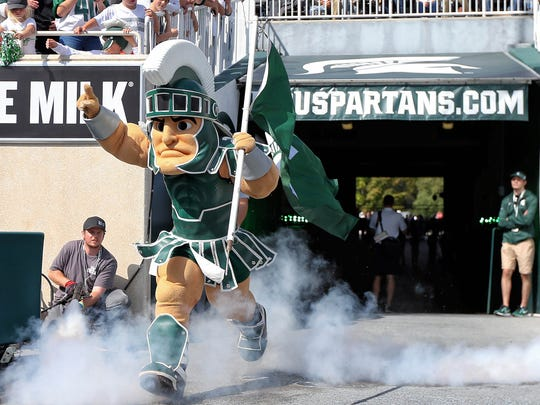 "Sep 9, 2017; East Lansing, MI, USA; Michigan State Spartans mascot ""Sparty"" performs prior to a game against Western Michigan at Spartan Stadium."