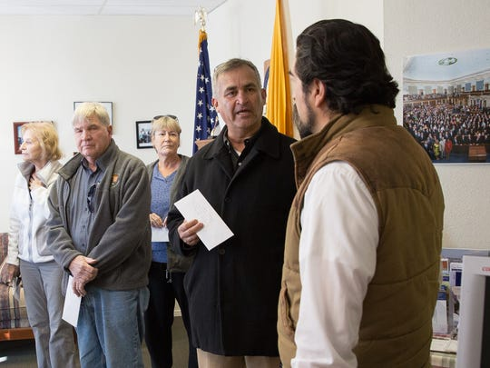 """Tony Martinez, the head of a recenlty formed group of concerned citizens, leads the group called """"We're In:Southern New Mexico"""" into, talks with Peter Ibarbo, the Director of Communtiy Outreach and Natural Resources for Congressman Steve Pearces in the Congressmans  Las Cruces offices where Martinez along with the othe rmembers of their group delivered letters detailing concerns they have about President Elect Trumps agenda concerning the Affordable Care Act. Wednesday January 18, 2017."""