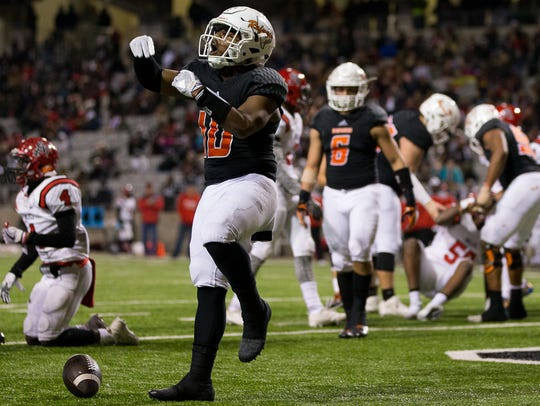 Refugio's Jacobe Avery celebrates after scoring a touchdown