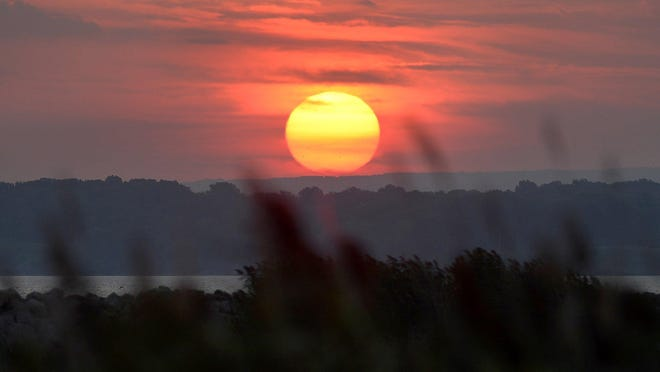 The sun rises over Erie, looking east from the south pier of the Presque Isle Channel. Erie recorded its second-hottest July in city history with an average temperature of 76.5 degrees, according to the National Weather Service in Cleveland.