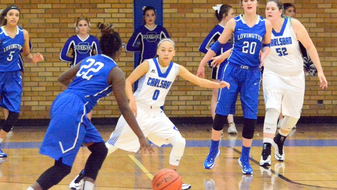 Carlsbad's Baylee Molina looks to get a stop against Lovington's Japeria Wright in the first quarter Monday.