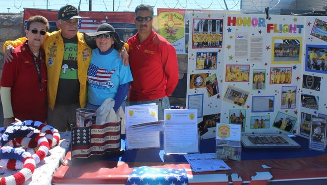 Honor Flight of Southern New Mexico team members work at an informational booth during a recent outreach. The group is looking for volunteers.