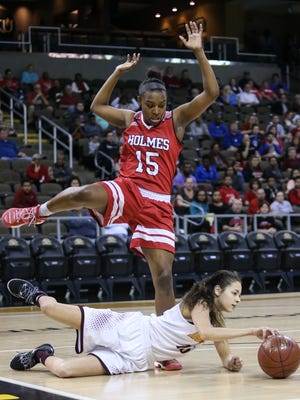 Holmes' Tyra Englemon tries to avoid stepping on Cooper's Asyah Mitchell during Holmes' 58-52 win in the Girls' Ninth Region Basketball Tournament championship game at NKU's BB&T Arena, Sunday, March 5, 2017.