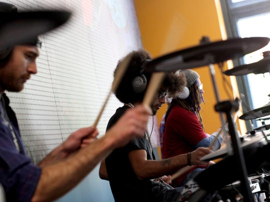 Students play the electronic drum kits at the Detroit Institute of Music Education.