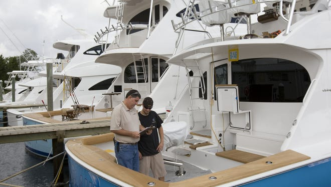 Joseph Stephano (left), a quality control inspector for Viking Yacht in Bass River, and Matt Weber, an electronic technician, get a 60' yacht ready for delivery to a customer in Delaware in this 2008 file photo.