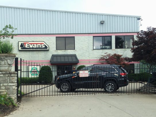 FBI agents search the premises of Evans Landscaping