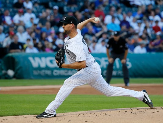 Chicago White Sox starting pitcher Mike Pelfrey delivers during the first inning of the team's baseball game against the Chicago Cubs on Thursday, July 27, 2017, in Chicago. (AP Photo/Charles Rex Arbogast)