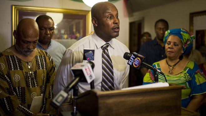 Andres Landor, a former Lafayette Police Department officer, speaks during a press conference at Imani Temple #49 in Lafayette, La., Tuesday, July 14, 2015.