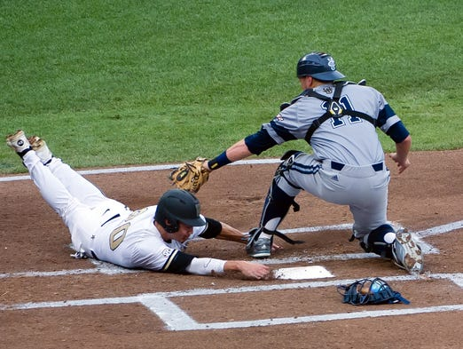 Vanderbilt's Bryan Reynolds  slides around the tag of UC Irvine catcher Jerry McClanahan to score the Commodores' second run Monday.