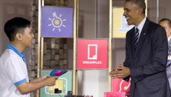 President Barack Obama tours a high-tech displays in