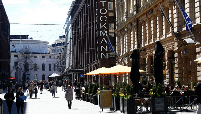 People walk past Stockmann shopping center in Helsinki, Finland, on May 6.