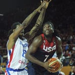 USA Basketball forward Kenneth Faried (R) gets ready to shoot againsat Dominican Republic's forward Edward Santana (L) in Team USA's win Wednesday.