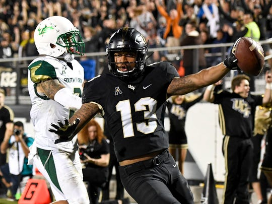 Nov 29, 2019; Orlando, FL, USA; Central Florida Knights wide receiver Gabriel Davis (13) catches the ball for a touchdown during the second quarter against the South Florida Bulls at Spectrum Stadium. Mandatory Credit: Douglas DeFelice-USA TODAY Sports