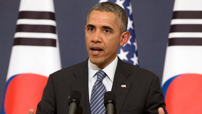 President Obama speaks at a joint news conference with South Korean President Park Geun Hye at the Blue House on April 25  in Seoul. Obama said the U.S. and Europe are laying the groundwork to sanction broad sections of Russia's economy if Moscow invades eastern Ukraine, but he acknowledged those sanctions may fail to deter Vladimir Putin.