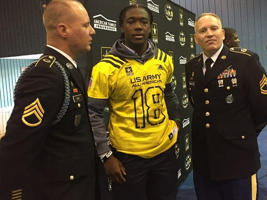 Following the Tuesday ceremony, U.S. Army Bowl selectee Micah Baskerville visited with Captain Floyd Hill, Sgt. 1st Class Curtis Hissong and Staff Sgt. Christopher Lane.