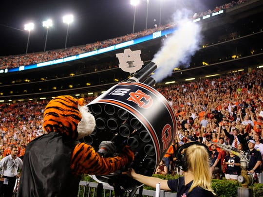 Aubie the Tiger, the mascot for Auburn, fires a T-shirt gun on Sept. 6, 2014, in a game against San Jose State.