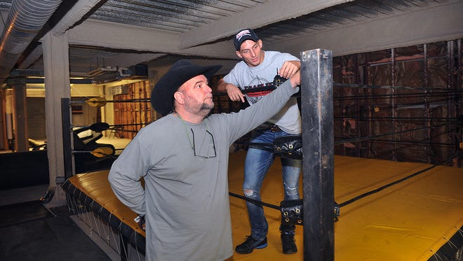 Johnny Mantell, left, and Dusty Gold talk about the improvements to be made to a practice ring and gym space in the third floor of the First Wichita Building Annex. The gym will be above the Professional Wrestling Hall of Fame and Museum and will offer space and equipment for fitness training as well as clinics and training for amateur wrestlers.