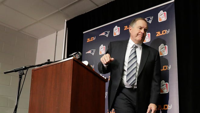 New England Patriots head coach Bill Belichick finishes answering questions at a news conference after an NFL football game against the New York Jets, Sunday, Nov. 27, 2016, in East Rutherford, N.J. The Patriots won 22-17.